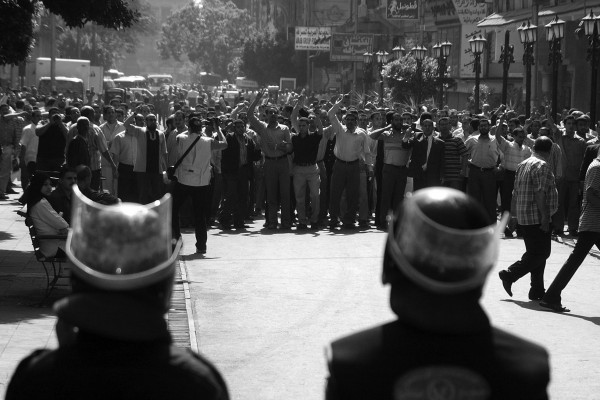 Anti-riot police facing protestors near a Cairo court where pro-reform judges were being questioned by a disciplinary tribunal, in May 2006.