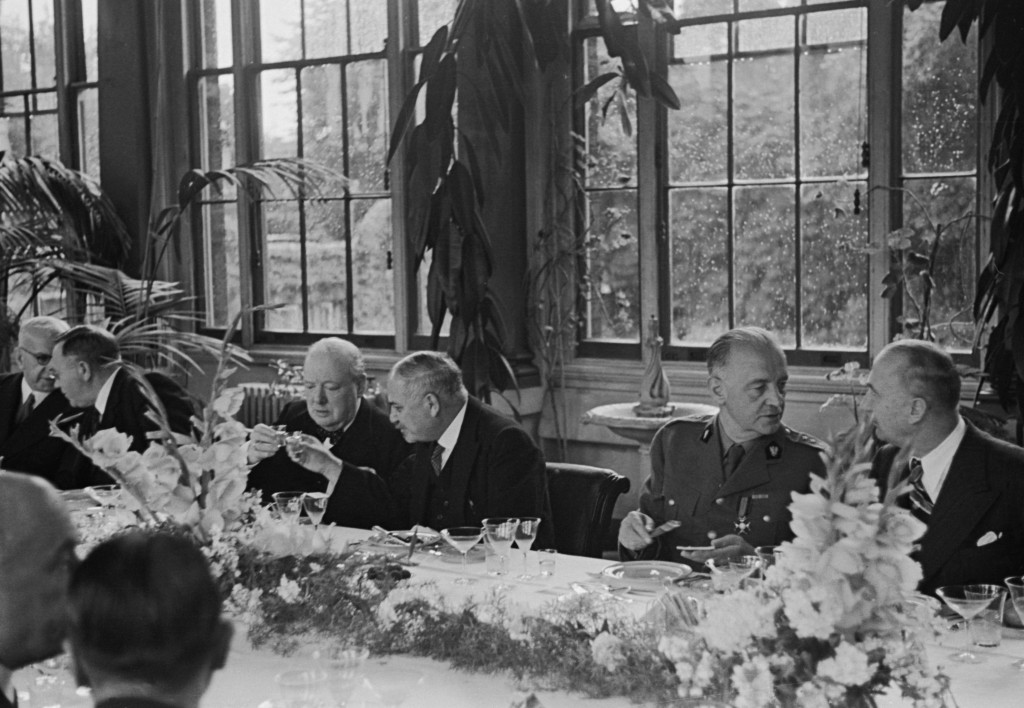 Guests at a lunch party in the Winter Garden of the Soviet Embassy in London, given by Soviet Ambassador Ivan Maisky (1884 - 1975), August 1941. Maisky clinks glasses with British Prime Minister Winston Churchill (1874 - 1965) . Original Publication : Picture Post - 864 - The Most Important Lunch Party Of The War - pub. 1941 (Photo by Picture Post/Hulton Archive/Getty Images)